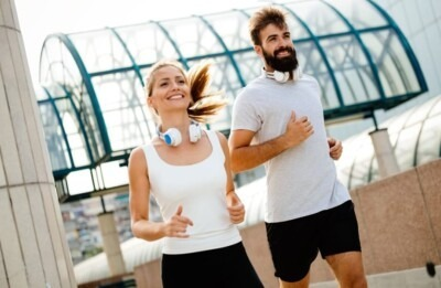 A couple running may need sports mouthguards from their dentist