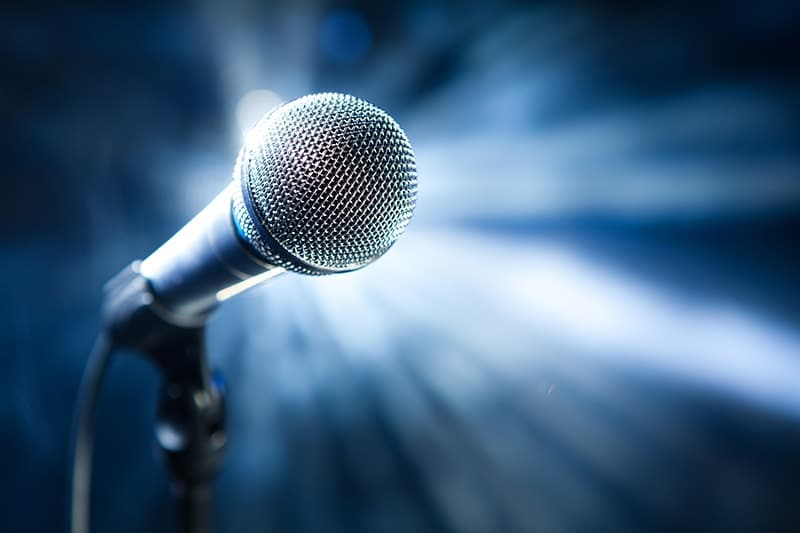 A single microphone on a stage with a bright blue background. Just like in American Idol, there can only be 1 winner. When you visit Dr. Pamela Marzban in Burke, VA you'll receive a #1 smile, unique just to you.